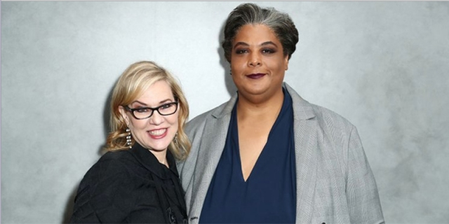 Roxane Gay and Debbie Millman standing against a grey wall.