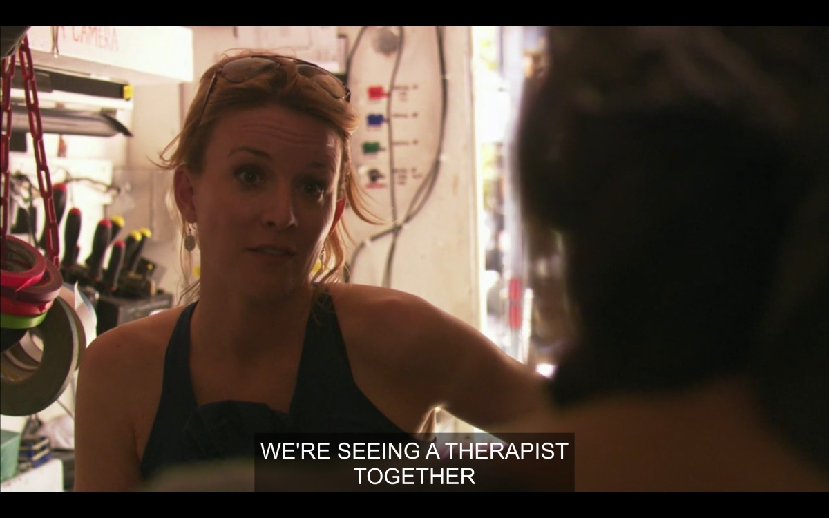Tina telling Sam that she is seeing a therapist with Bette, in a trailer on the set of Lez girls
