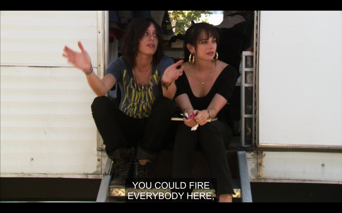 Shane and Jenny sitting outside the trailer at Lez Girls