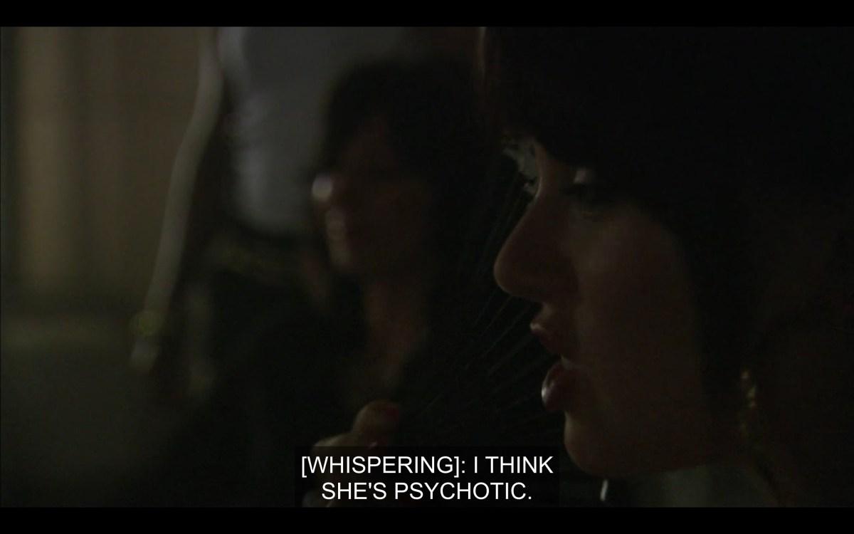 "Jenny whispers to Shane ""I think she's psychotic."" Close up on Jenny's face."