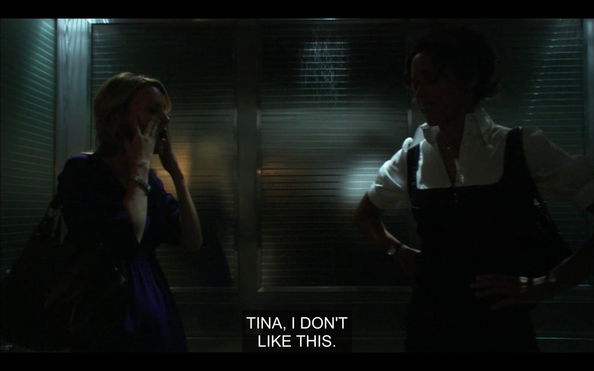 Tina and Bette in the elevator with the lights off