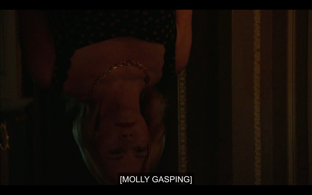 Upside-down Phyllis's head as Molly sees it