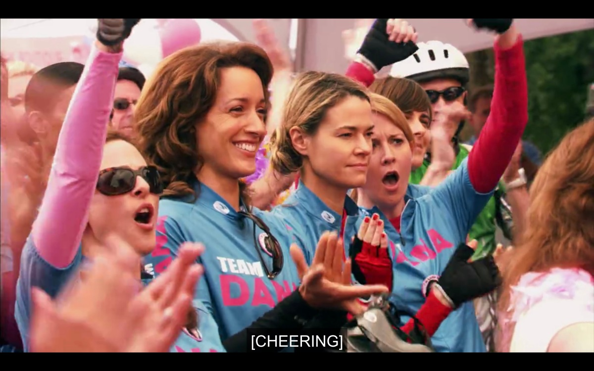 main L Word characters cheering at the start of the Pink Ride