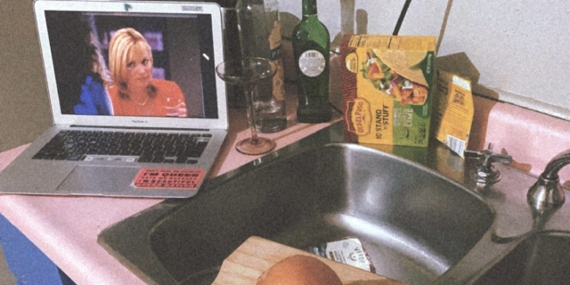 """""""Sex and the City"""" plays on Shell's laptop in her kitchen, which has a pink countertop."""