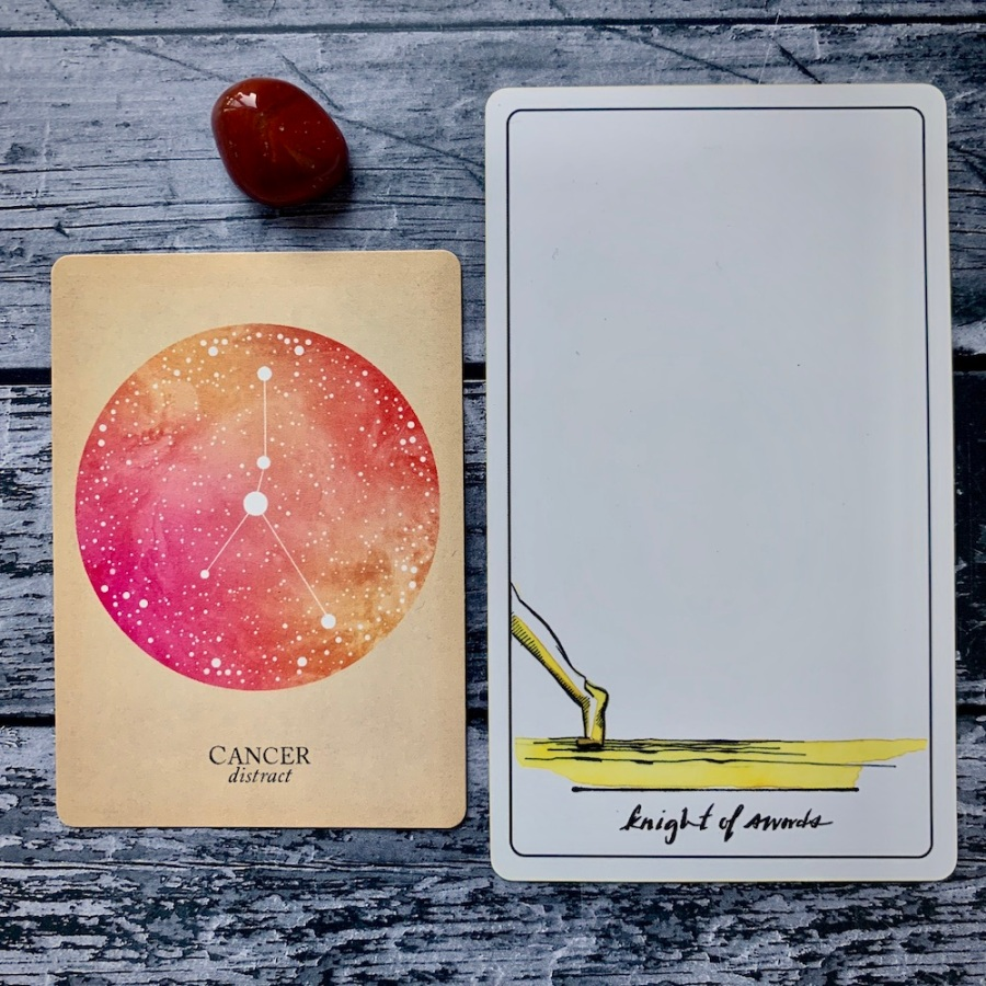 The Cancer card from the Constellations deck and the Knight of Swords card