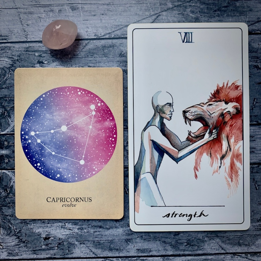 the Capricorn card in the Constellations deck and the Strength card