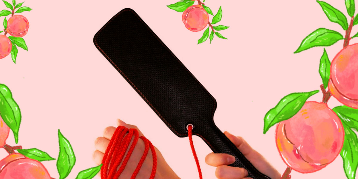 Scarlet Couture Paddle - a black paddle with a red rope attached.