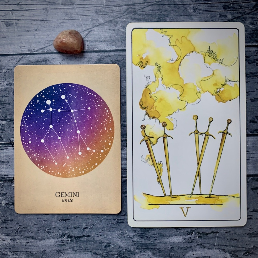 A Gemini card from the Constellations deck and the 5 of Swords card