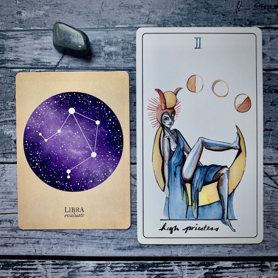 the Libra card from the Constellations deck and the High Priestess card