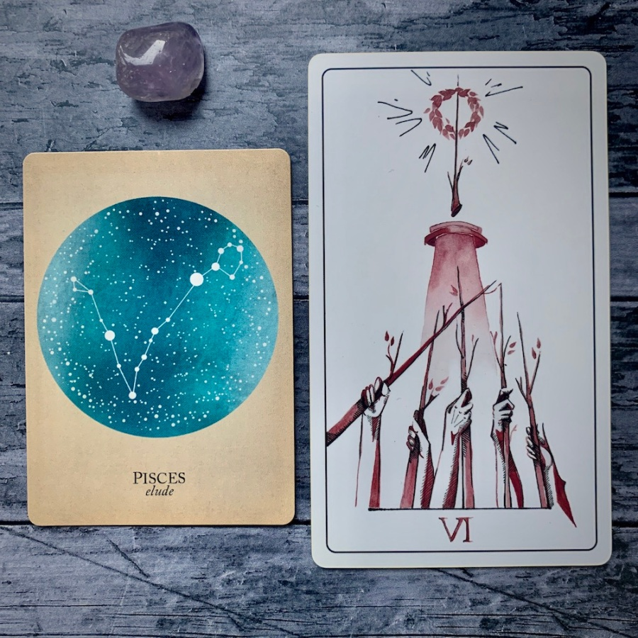 the Pisces card from the Constellations deck and the Six of Wands card