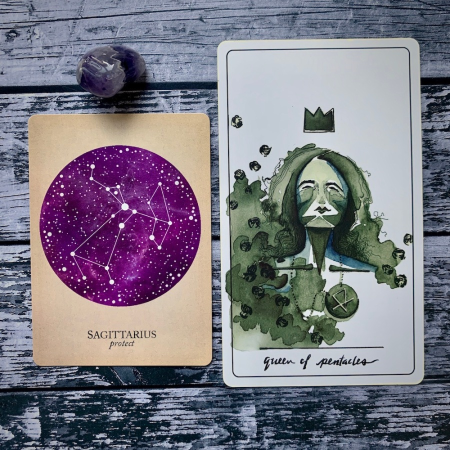 the Sagittarius card from the Constellations deck and the Queen of Pentacles card