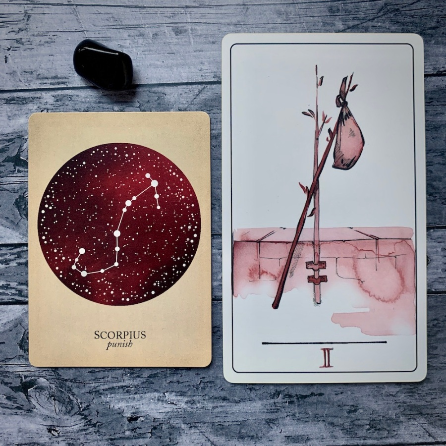 the Scorpio card from the Constellations deck and the Two of Wands card
