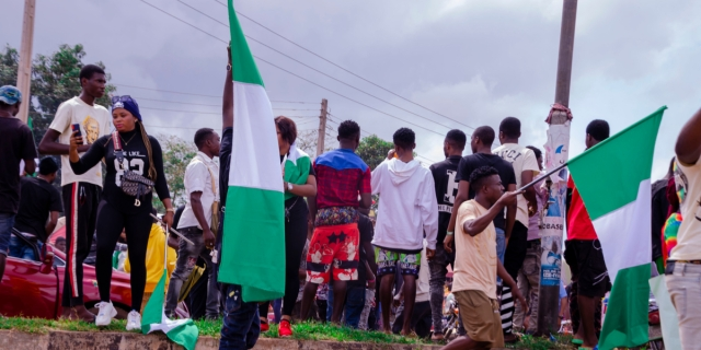 LAGOS, NIGERIA - OCTOBER 19, 2020: group of nigerian youths protesting around the city about end sars, end bad government, end police brutality in Nigeria.
