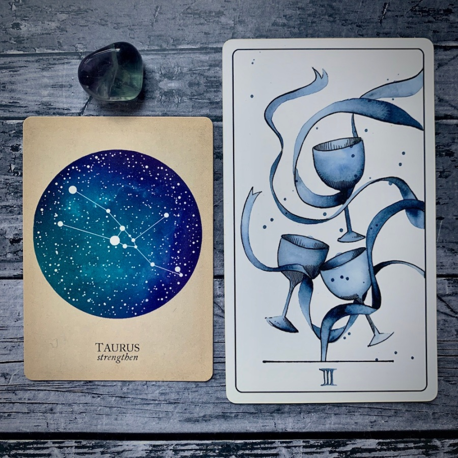 A Taurus card from the Constellations deck and a 3 of Cups card