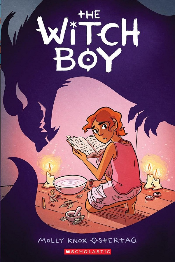 The cover of WITCH BOY features an illustrated figure of a thin young person with orange curly hair crouched over a spellbook, bowl and candles while a shadowy menacing dragon figure looms over them from behind.