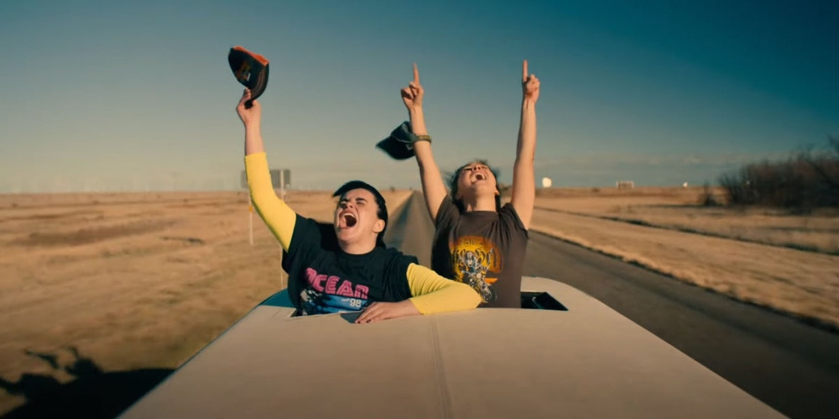 "two girls screaming out the top of a car on a desert highway, from ""Unpregnant"""