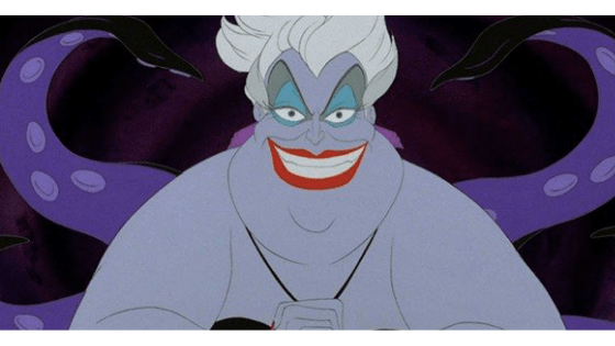 A still of Ursula from the Little Mermaid movie, a fat lavender-skinned merwoman with octopus tentacles, bright red lipstick, and white hair