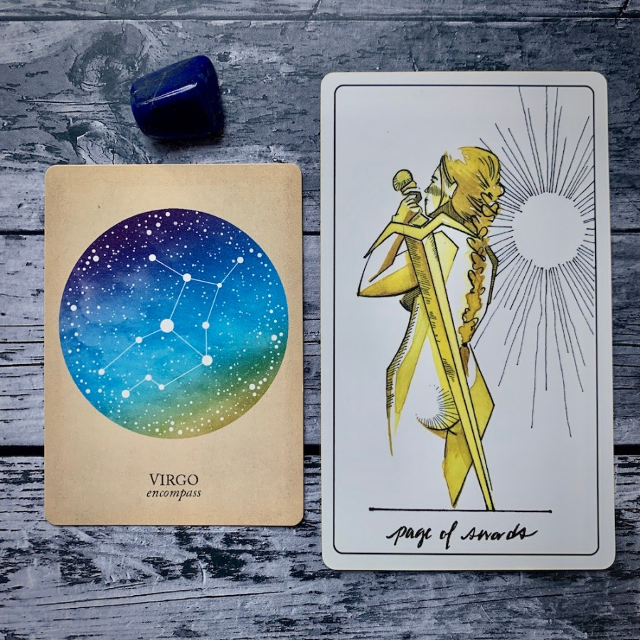 the Virgo card from the Constellations deck and the Page of Swords card