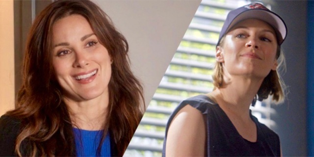 A collage of Carina DeLuca from Grey's Anatomy smiling at Maya Bishop from Station 19. Carina is in a blue shirt and black blazer with her long wavy brown hair around her shoulders. Maya has on a cut off tank top and a baseball cap over her chin-length blonde bob.