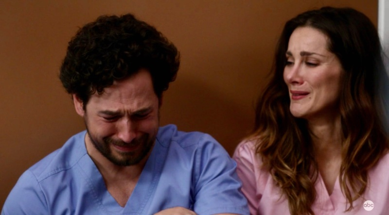 """Carina DeLuca cries on the floor with her brother in a hospital lounge on """"Grey's Anatomy"""""""