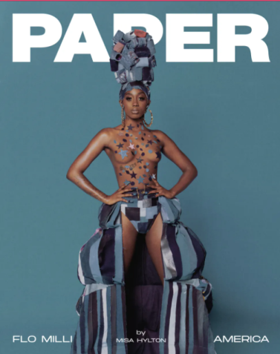 Rapper Flo Milli on the cover of PAPER magazine posing in a hat made of denim, cutout denim long skirt and shapes cut out of denim material over her upper body.