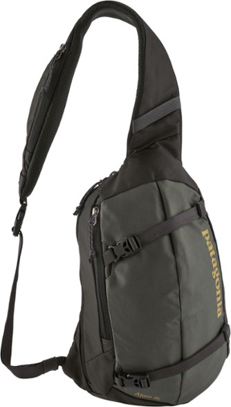 """A black over-the-shoulder bag that reads, """"Patagonia"""""""