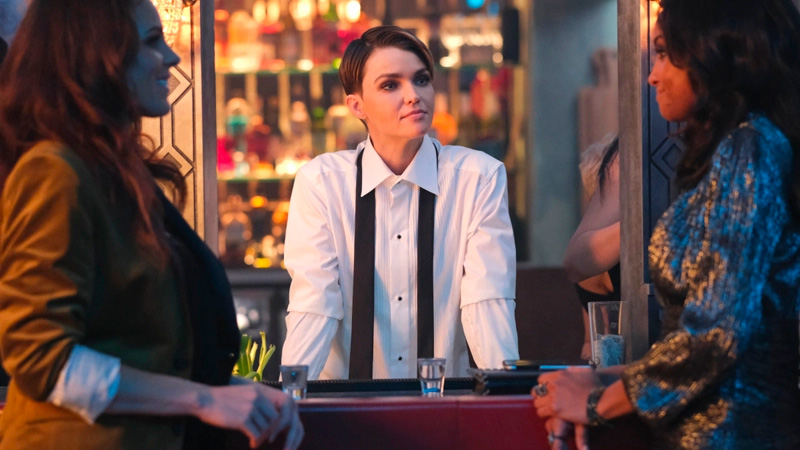 Kate stands between Sophie and Nocturna in a tux shirt with the tie undone