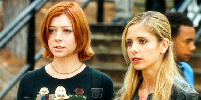 Willow and Buffy standing side by side in Buffy the Vampire Slayer.