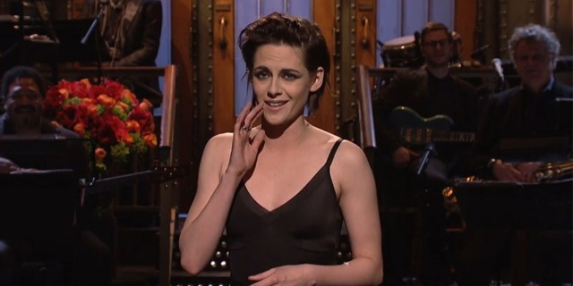"Kristen Stewart hosting Saturday Night Live in 2017. She holds her hand up to her mouth to amplify, ""I'm like, so gay, dude."" It's an iconic moment of lesbian pop culture history."