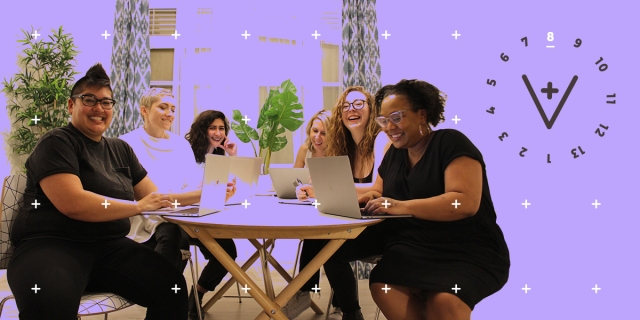 The team: Kamala, Sarah, Riese, Laneia, Rachel, Carmen gathers around a table at their last staff retreat, laughing and working on their computers. This image has the 13 Days of A+ treatment with a lavender wash and the A+ logo indicating that it is day 8