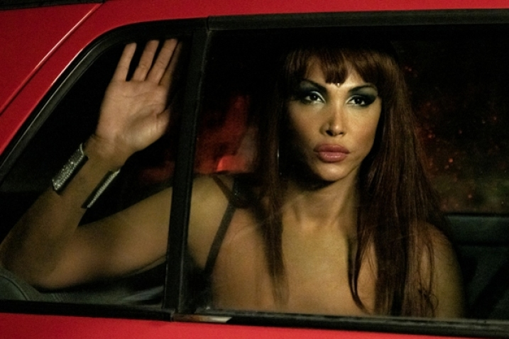 "Christina Oritz in a car with her hand on the window in ""Veneno"""