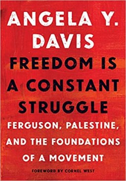 A book cover with a red background and white and black text that reads: Angela Y. Davis Freedom Is A Constant Struggle: Ferguson, Palestine, and the foundations of a movement