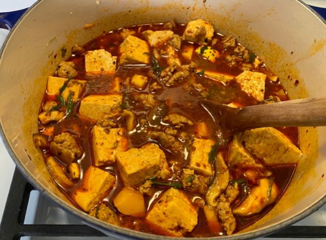 mapo tofu simmering on the stove