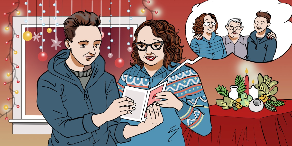 Two people reading a Christmas card.