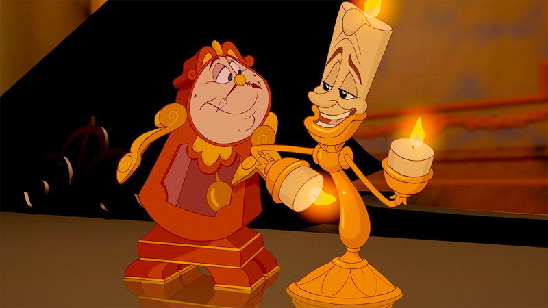 Bisexual Disney characters Lumiere and Cogsworth hug it out.