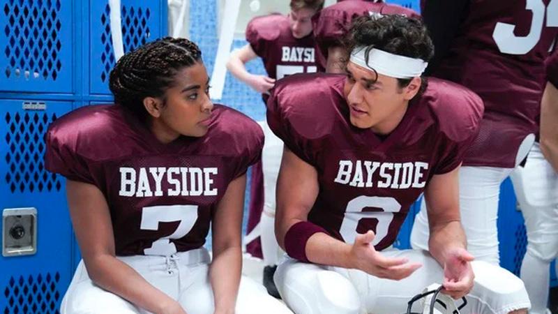 Aisha (Alycia Pascual-Pena) in her football jersey in the Bayside High locker room.