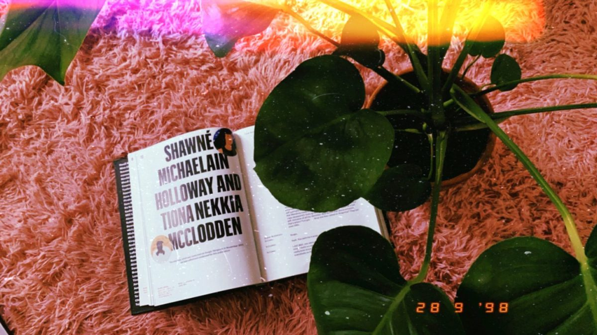 """Image shows an excerpt from the book """"Black Futures"""" where a conversation is held between Shawne Michaelain Holloway & Tiona Nekkia McClodden. There is a plant in the frame."""