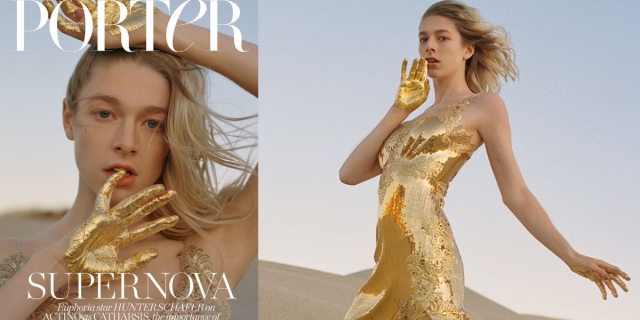 Hunter Schafer has her hands painted gold while wearing a gold spaghetti strapped dress in the desert on the cover of the Net-a-Porter fashion magazine