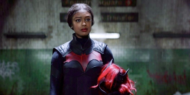 In this review of Batwoman season two, Ryan Wilder is in the Batsuit with her wig and make held in her arms.