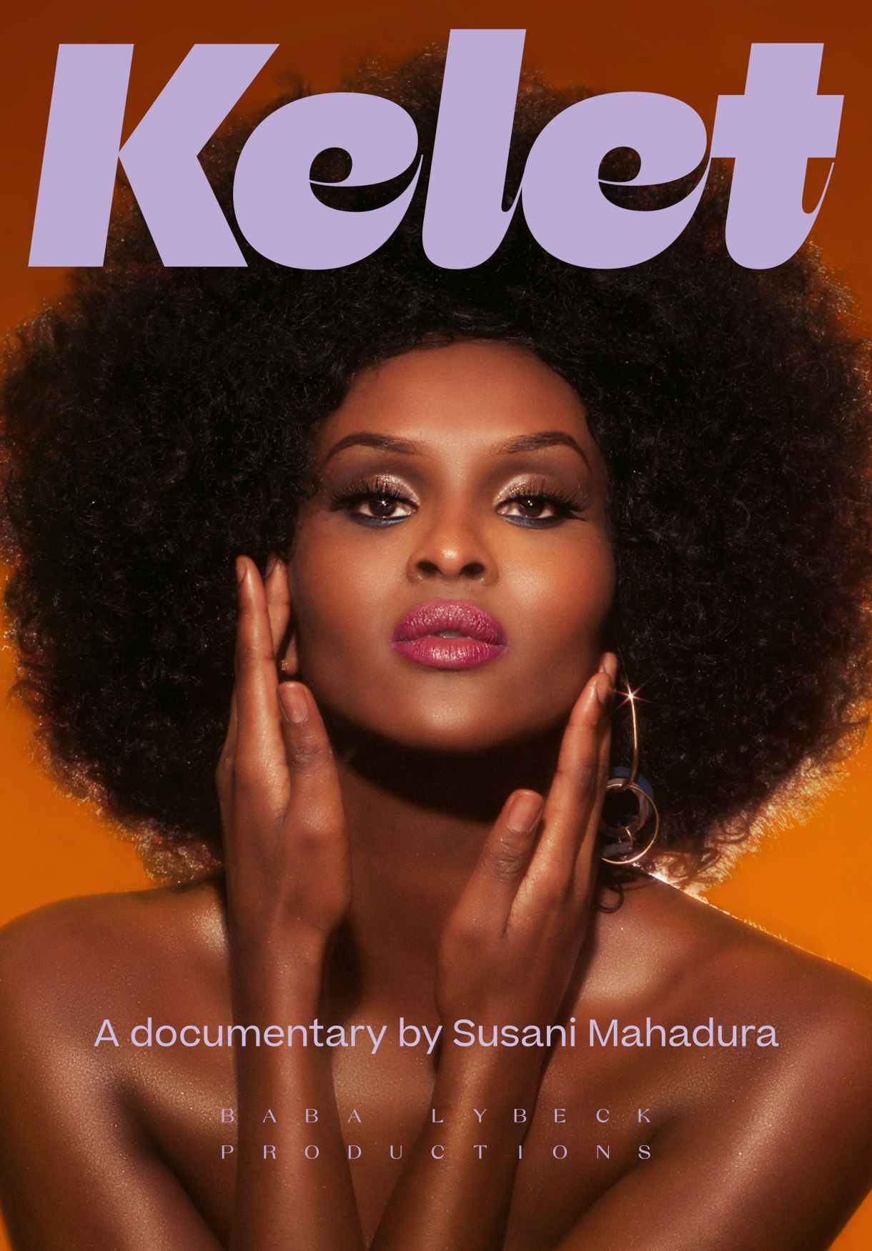 """Image shows a beautiful black dark skinned woman with flawless makeup and a large afro staring into the camera. Her shoulders are bare and her hands are softly framing her face. Purple text reading """"Kelet"""" is above her."""