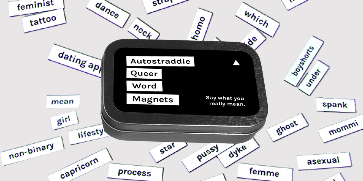 An Autostraddle Queer Word Magnet kit sits on an array of queer words, including boyshorts, spank, mommi, asexual, femme, and mean.