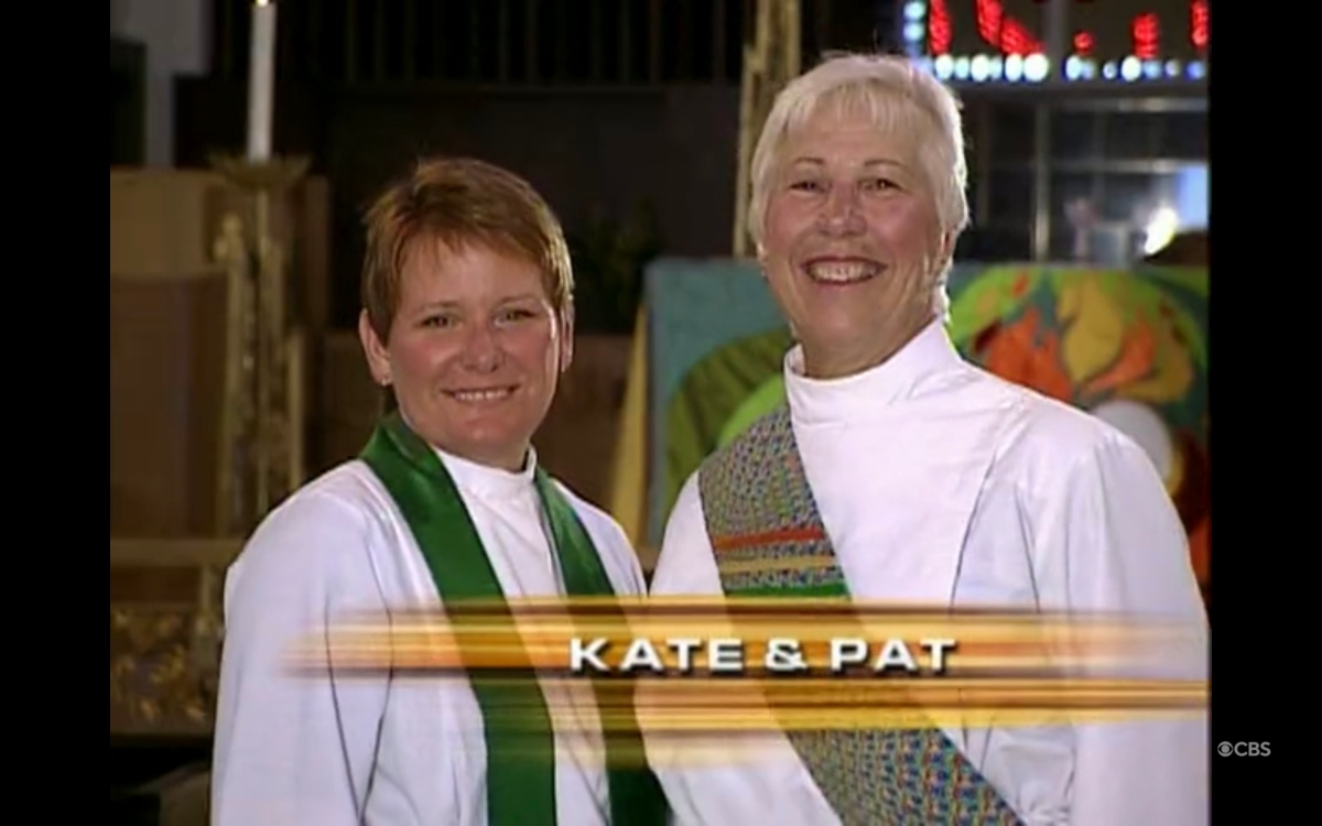 lesbian ministers Kate + Pat smiling at the camera in the opening credits