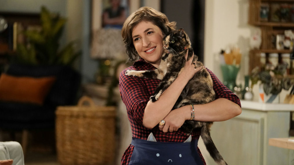 Mayim Bialik holds a cat in Call Me Kat.