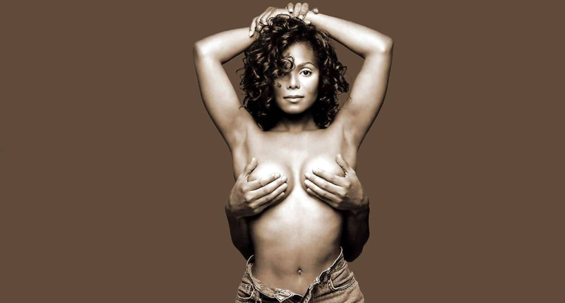 The famous image of Jackson from the cover of Rolling Stone has Jackson topless, with a person holding her breasts in her hands. She is wearing unbuttoned jeans. The photo is against a sepia background.