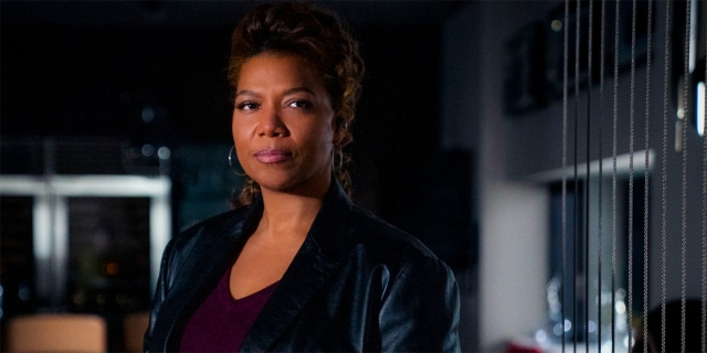 Queen Latifah wears a leather jacket and looks like a badass in a promo photo for CBS' Equalizer.