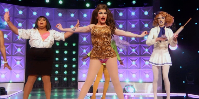 Rosé shine center stage in a brunette wig and brown patterned body suit on the Drag Race runway.
