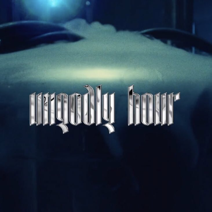 "Image shows dark teal background with the text ""Ungodly Hour"" written in silver chrome colored font."