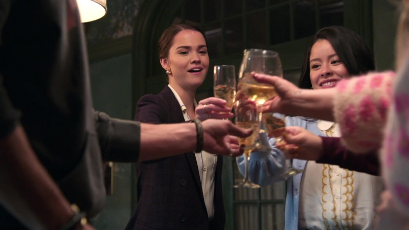 Callie celebrates passing the bar and getting a new job with her chosen family at the Coterie.