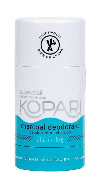 "A cylindrical white and blue deodorant stick reads, ""Kopari: charcoal deodorant"""