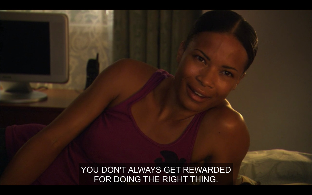 Tasha looking hot in a tank top telling Alice that you don't always get rewarded for doing the right thing
